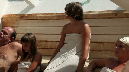 Family relaxing in a sauna