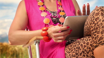 Woman tapping on a tablet PC