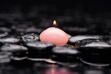 Still life with pink candle with therapy stones