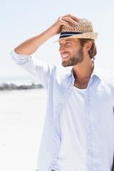 Handsome man smiling on promenade
