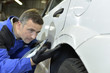 Mechanic checking on auto bodywork