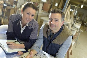 Portrait of smiling workers in carpentry workshop