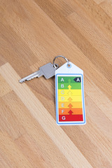 Home key with energy label on wood