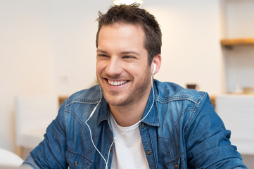 Happy man listening music