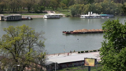 Shot of ferry with sand on river in Belgrade with surroundings