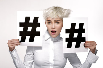 pretty blond model showing two hashtag sign on paper