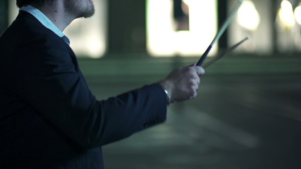 Somebody plays drums in the air with the drum sticks in slow motion