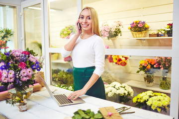 Successful florist in flower shop
