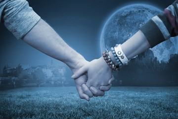 Composite image of students holding hands