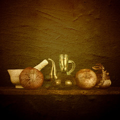 Olive oil, onions and mortar rustic background