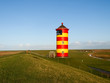 Pilsum, lighthouse at North sea of Germany. - 77527505