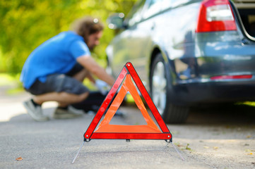 Red warning triangle sign on the road