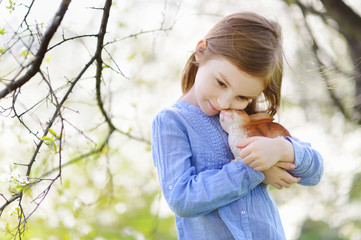 Adorable little girl holding easter bunny