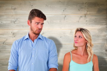 Composite image of young couple making silly faces
