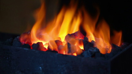 Bright flame of fire burns in a forge horn
