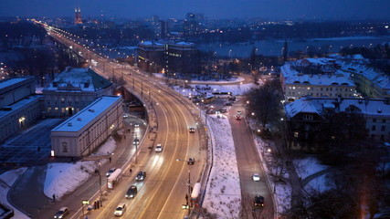 Movement of cars on the night street in Warsaw in the winter, th