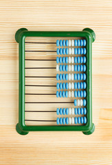 Close-up of abacus on wooden desk