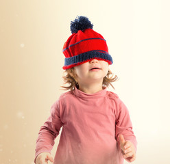 Little girl with Christmas hat over white background