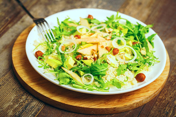 Salad couscous rucola and nuts avocado