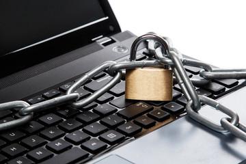 Padlock and chain on keyboard
