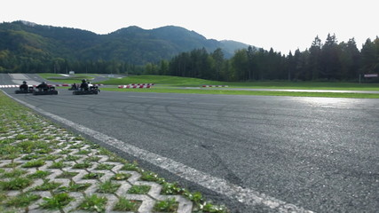 VRANSKO, SLOVENIA - SEP 2013: Go-cart drivers start to compete for the first place. Go-cart and cars simulations event.