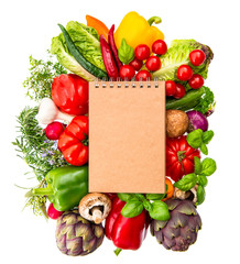 recipe book with fresh vegetables and herbs. healthy food ingred