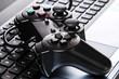 Gamepad is lying on a keyboard - 77532540