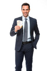 businessman smiling and holding money