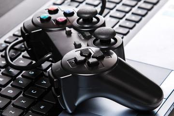 Gamepad is lying on a keyboard
