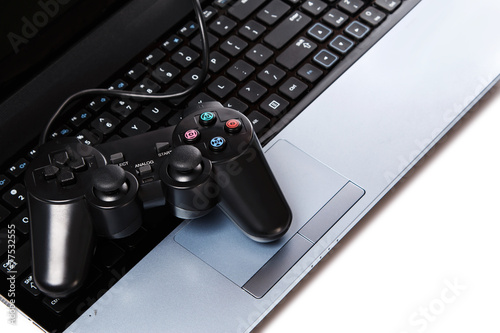 Gamepad is lying on a keyboard