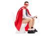 Superhero sitting on a toilet