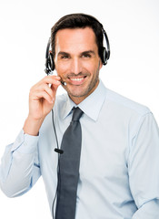 smiling man with headset working as a call center operator