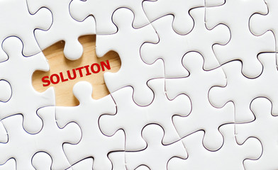 Solution word on jigsaw puzzle, business concept