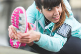 Young Woman Doing Stretching Exercises before Jogging