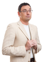 handsome man in white suit and glasses thinking