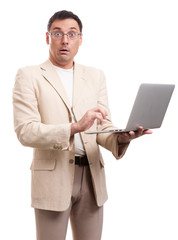surprised man wearing suit and glasses with laptop