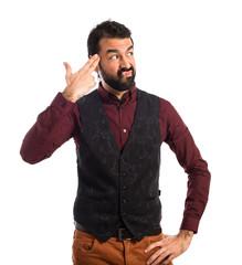 Man wearing waistcoat making suicide gesture