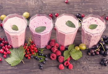 Various fresh berries smoothies top view