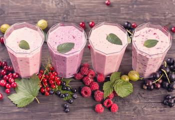 Various fresh berries smoothies top view