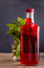 Cranberry alcohol drink in bottle