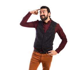 Man wearing waistcoat thinking