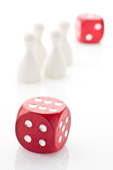 Two dice and gaming pieces