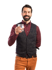 Man holding water glass