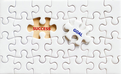 Success and goal words on jigsaw pazzle,business background