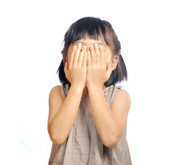 asian little girl cover her face with her hand isolated in white