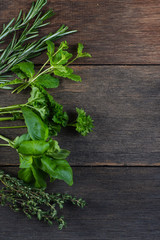 Freshly cliped herbs on wooden background