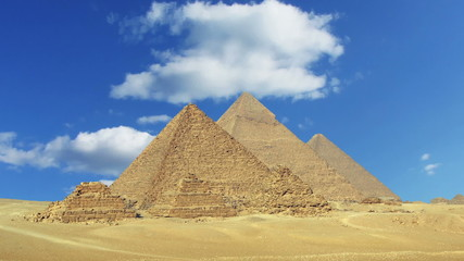 Clouds over great pyramids at Giza Cairo in Egypt - zoom in time