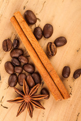 coffee beans and cinnamon stick on table