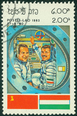 stamp printed by Laos, shows astronaut