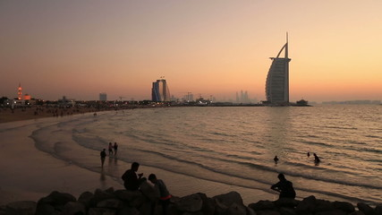 people watching sunset at Jumeriah Beach in Dubai